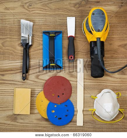 Sanding And Painting Accessories On Faded Wooden Boards