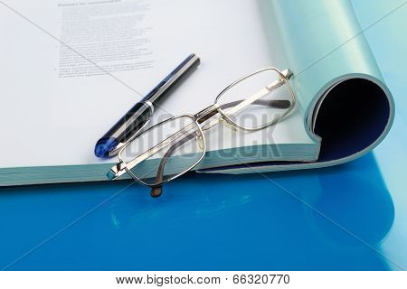 Glasses lying on a book