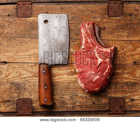 Raw Fresh Meat And Meat Cleaver On Wooden Background