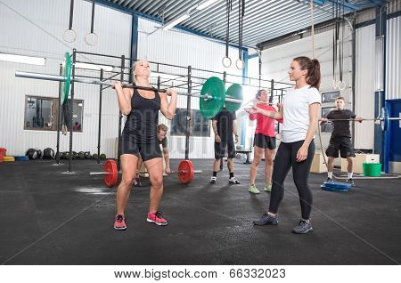 Workout team training at fitness center