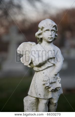 Statue of Angel Boy at Sunset