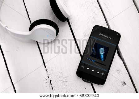 Modern Smartphone On The wooden board with wireless headphones.