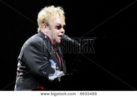 Elton John performing live.