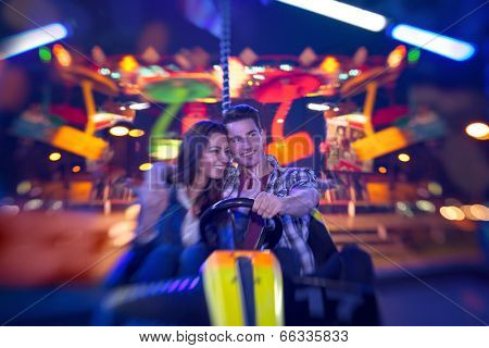 couple in bumper car playing an attractions park - shoot with lensbaby