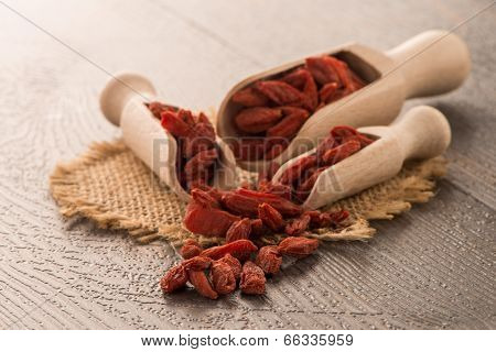 Goji Berries On A Wooden Spoons