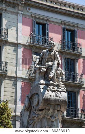 Old Statue In Barcelona Plaza