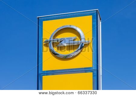 Samara, Russia - June 8, 2014: Opel Dealership Sign Against Blue Sky. Opel Is A German Automobile Ma