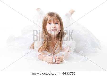 Little Girl Wear Dress Lay On The Floor