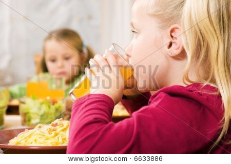 Children having noodles