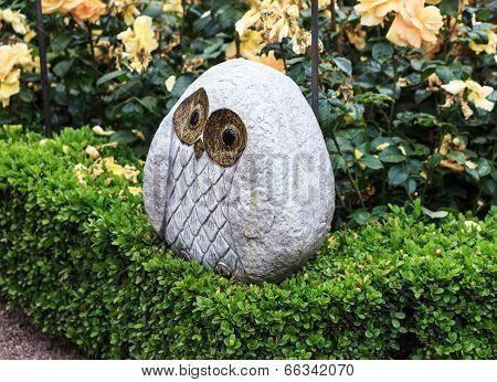 Owl sculpture in a Rose Garden