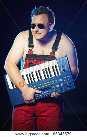 Musician holding a keyboard