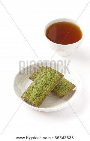 maccha green tea financier cake and cup of tea