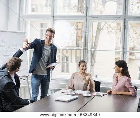 Young business team enjoying success at conference table