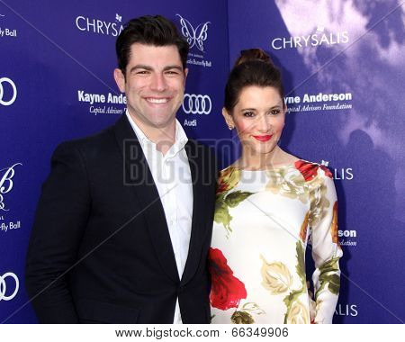 LOS ANGELES - JUN 7:  Max Greenfield, Tess Sanchez at the 13th Annual Chrysalis Butterfly Ball at Private Mandeville Canyon Estate on June 7, 2014 in Los Angeles, CA