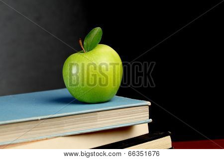 Stack Of Exercise Books And Green Apple
