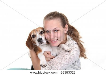 happy owner hugging pet Beagle dog