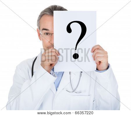 Portrait Of Doctor Holding Paper With Question Mark
