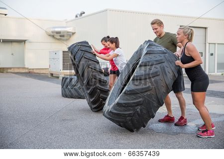 Workout team flipping tires outdoor