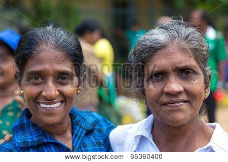 HIKKADUWA, SRI LANKA - FEBRUARY 23, 2014: Portrait of two local women at Sunday market. It is a great way to see Hikkaduwa's local life come alive along with fresh produce and local delicacy.