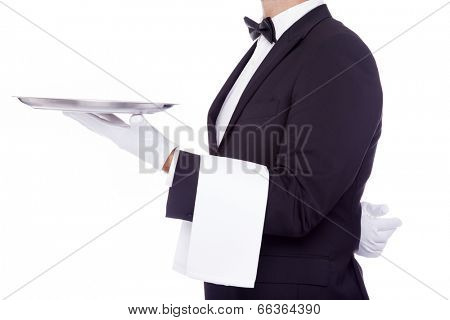Young waiter holding an empty dish on white background