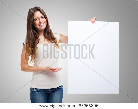 Woman showing a blank white board