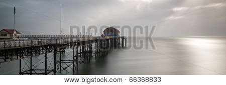Landscape Panorama Long Exposure Peaceful Image Of Mumbles Pier In Wales