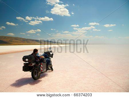 TUZ GOLU, TURKEY - AUGUST 25: Man with his bike at salt lake(Tuz Golu) on august 25, 2013, Turkey.