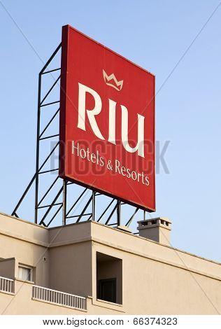 Puerto Rico, Spain - June 26, 2011: RIU Hotels & Resorts logo on billboard on top of RIU Vistamar Hotel. RIU is the 27th largest Hotel chain worldwide.