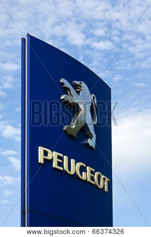 Ratingen, Germany - May 29, 2011: Peugeot sign at a car dealer's building. Peugeot is a major French car brand, part of PSA Peugeot Citroen, the second largest carmaker based in Europe.