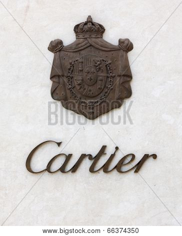 Dusseldorf, Germany - August 20, 2011: Cartier signage with coat of arms of the Cartier family on wall. Cartier S.A., is a French luxury jeweler and watch manufacturer headquartered in Paris, France.