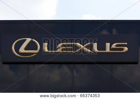 Dusseldorf, germany - June 12, 2011: Golden Lexus sign on car retailer's building. Lexus is the luxury vehicle division of Japanese car manufacturer Toyota Motor Corporation.