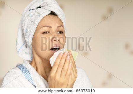 woman in a white bathrobe