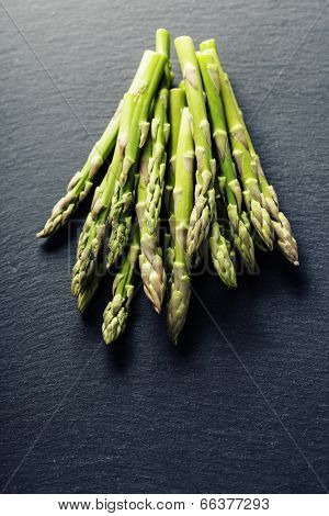 Bunch of fresh asparagus on slate background
