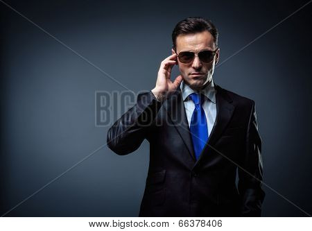 Business man in suit and sunglasses