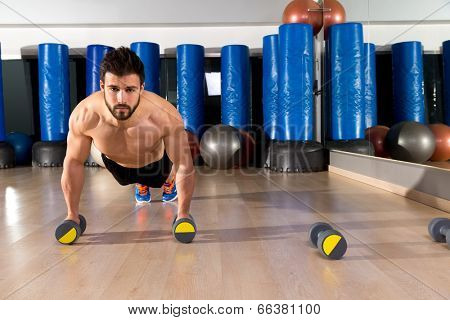 Dumbbells push-ups pushups beard man at fitness gym workout