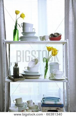 Different tableware on shelf in the interior