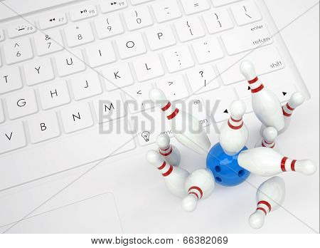 Bowling ball and skittles on the keyboard