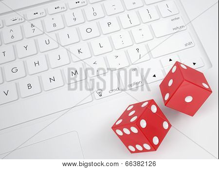 Red dice on the keyboard