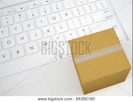 Closed cardboard box on the keyboard