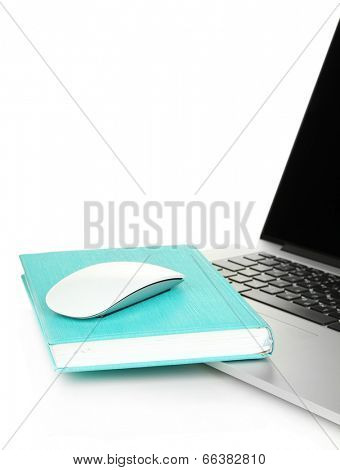Computer mouse on book and notebook isolated on white