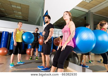 Gym people group relaxed after training with fitball workout