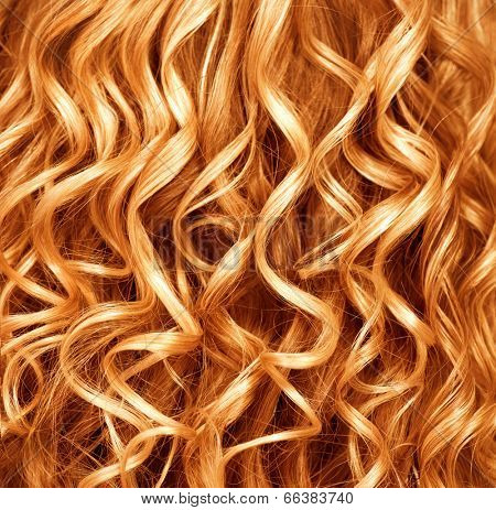 Curly Red hair closeup. Wavy blond hair background. Close up texture of long permed hair. Hairstyle