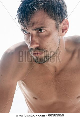 Half Naked Man with Beard in white background.