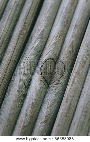 Heart Etched in Wooden Sticks up close.