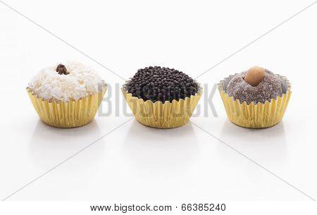Three Brazilian Sweets - Beijinho, Brigadeiro And Cajuzinho