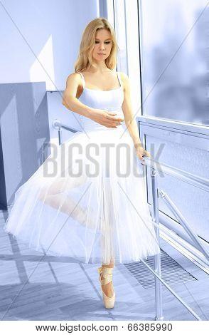 Beautiful balerina practicing in ballet class