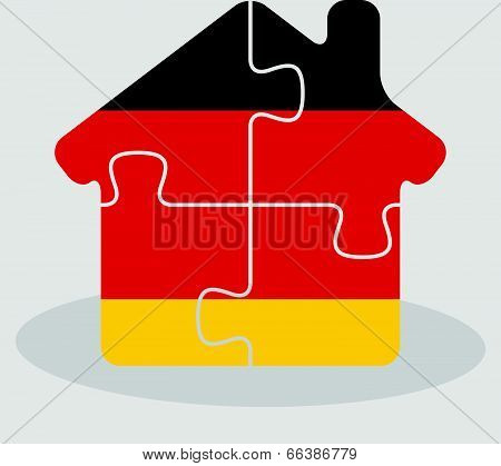 house home icon with German flag in puzzle