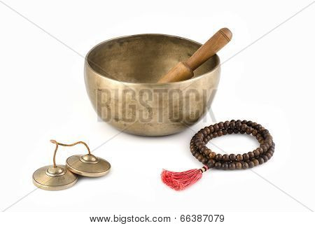 Singing Bowl, Prayer Beads and Meditation Bells.