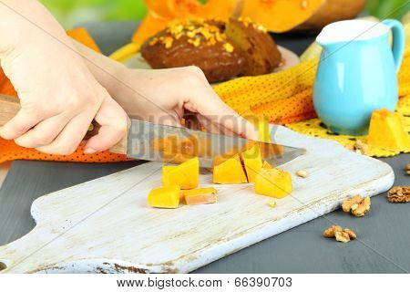 Cooking pumpkin pie on wooden table on natural background