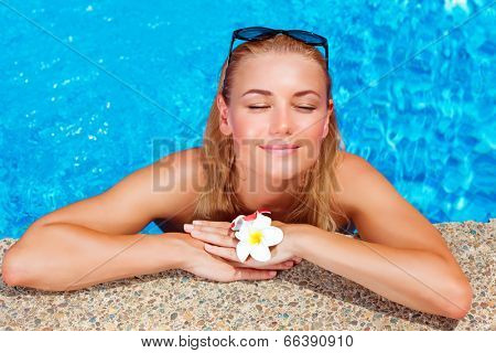 Female enjoying summer holidays, woman on day spa relaxation, sexy girl in the pool, luxury vacation on tropical resort, leisure and recreation concept